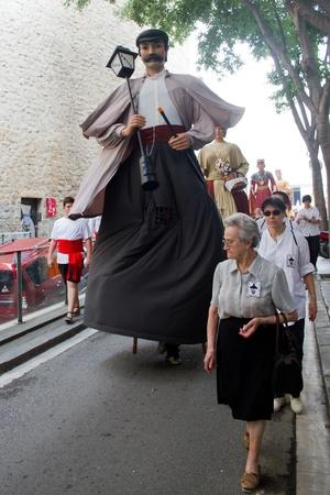 BARCELONA - JULY 17: Giants and big heads (Gigantes y Cabezudos) in Festa Major del Raval Festival on July 17, 2011 in Raval, Barcelona, Spain