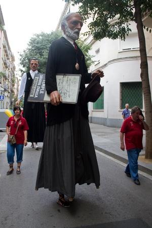 merce: BARCELONA - JULY 17: Giants and big heads (Gigantes y Cabezudos) in Festa Major del Raval Festival on July 17, 2011 in Raval, Barcelona, Spain