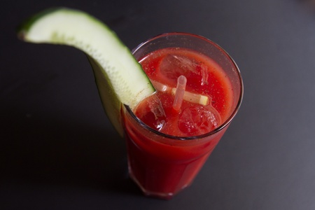 Virgin Bloody Mary garnished with cucumber  photo