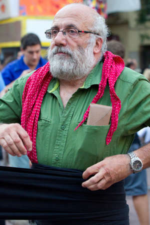 fireruns: BARCELONA - AUGUST 21: Member of the  Human Towers group (Colles Castelleres) preparing for the representation in the Gracia Festival 2011 (La Festa Major de Gracia 2011) on August 21, 2011 in Vila de Gracia, Barcelona, Spain Editorial