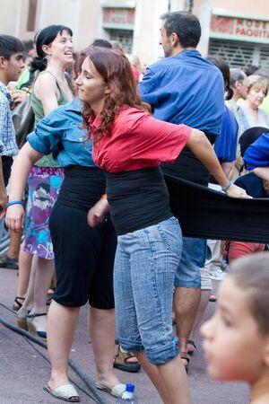 BARCELONA - AUGUST 21: Member of the  Human Towers group (Colles Castelleres) preparing for the representation in the Gracia Festival 2011 (La Festa Major de Gracia 2011) on August 21, 2011 in Vila de Gracia, Barcelona, Spain Stock Photo - 11924933