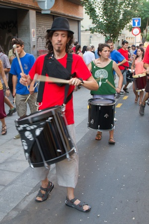fireruns: BARCELONA - AUGUST 21: Traditional drums band (gralla) in the Gracia Festival 2011 (La Festa Major de Gracia 2011) on August 21, 2011 in Vila de Gracia, Barcelona, Spain
