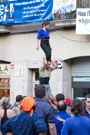 fireruns: BARCELONA - AUGUST 21: Human towers (Colles Castelleres) in the Gracia Festival 2011 (La Festa Major de Gracia 2011) on August 21, 2011 in Vila de Gracia, Barcelona, Spain Editorial