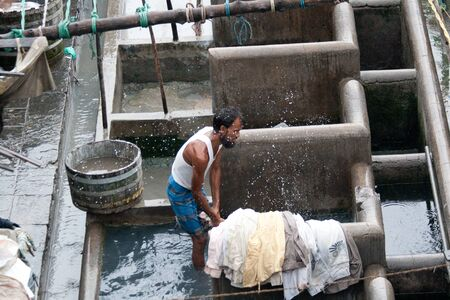 dhobi ghat: MUMBAI - JUNE 24: People at Dhobi Ghat, the world Editorial