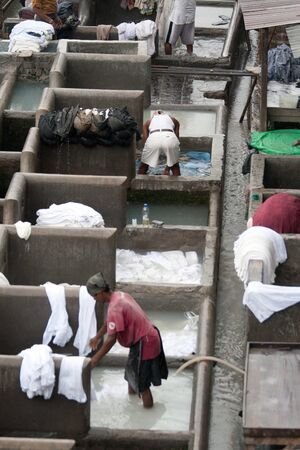 dhobi ghat: MUMBAI - JUNE 24: People at Dhobi Ghat, the worlds largest outdoor laundry on June 24, 2010 in Mumbai, India Editorial