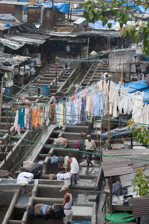 dhobi ghat: MUMBAI - JUNE 24: People at Dhobi Ghat, the worlds largest outdoor laundry on June 24, 2010 in Mumbai, IndiaMUMBAI - JUNE 24: People at Dhobi Ghat, the worlds largest outdoor laundry on June 24, 2010 in Mumbai, India Editorial