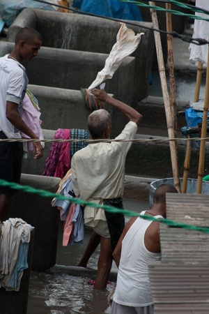 flogging: MUMBAI - JUNE 24: People at Dhobi Ghat, the world Editorial