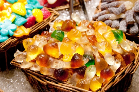 sugarcoat: Assorted colorful candies at the candy shop Editorial