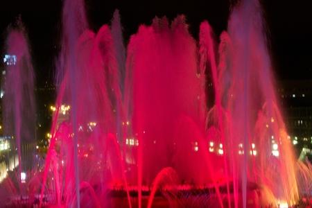 BARCELONA - JULY 25: Tourists at the Magic Fountain of Montju�c (Font m�gica de Montju�c) and Palau Nacional on the Montju�c, near Pla�a d