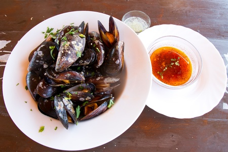 Plate of mussels with garlic and parsley  photo