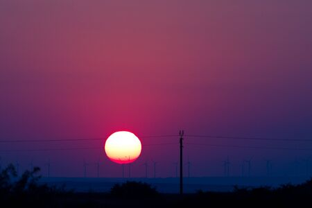Sunset and windmills by the Black Sea photo
