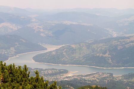 View of Ceahlau, Carpathian  Carpati  Mountains and Bicaz Lake and Viaduct, Romania photo