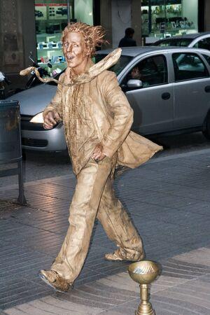 ramblas: BARCELONA - MAY 13  An unidentified young street in golden suit in Las Ramblas, Barcelona, Catalunia, Spain on 13 May 2010 Editorial