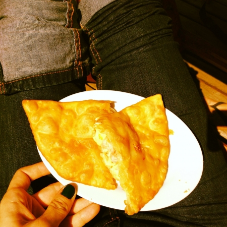 jeans: Woman hand holding plate of cheese and shrimps empanadas