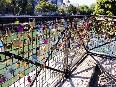 PARIS - SEPTEMBER 03  The love locks  Les cadenas de l amour  at Pont des Arts on September 3, 2013 in Paris, France