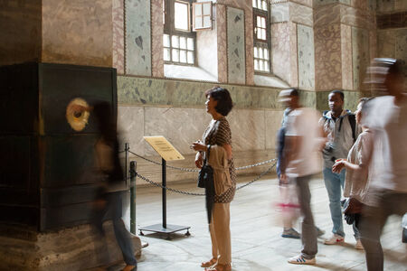 perspiring: ISTANBUL, TURKEY - SEPTEMBER 23: People at the perspiring column (wishing, sweating, crying column) inside Hagia Sophia on September 23, 2014 in Istanbul, Turkey