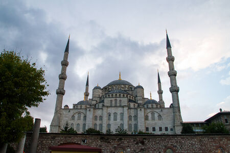 popularly: ISTANBUL, TURKEY - SEPTEMBER 23: Sunset at The Sultan Ahmed Mosque  (Turkish: Sultan Ahmet Camii), popularly known as the Blue Mosque  on September 23, 2014 in Istanbul, Turkey