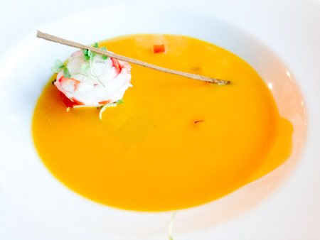 Pumpkin soup with sea food photo