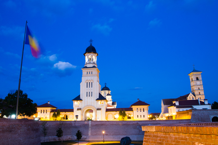 2nd century: ALBA IULIA - SEPTEMBER 09: Romanian flag at night in the fortress Alba Carolina, designed by architect Giovanni Morando Visconti, at the behest of Emperor Charles VI of Habsburg on the site of the ancient Apulum, founded by the Romans in the 2nd century A