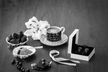 marmelade: Morning coffee setting with dry dates, orange marmelade and white lily