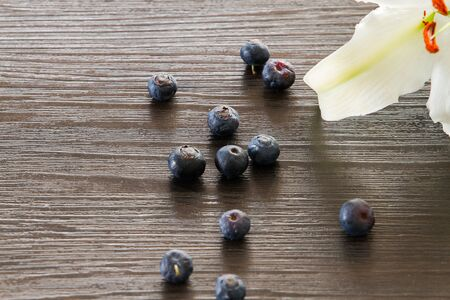 closedup: Blueberries closed-up with white lily petal