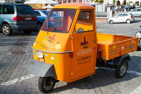 designated: SIBIU - SEPTEMBER 09: Funny, colored food delivery car in the center of Sibiu, city designated the European Capital of Culture for the year 2007. Sibiu, Romania on 09 September 2015