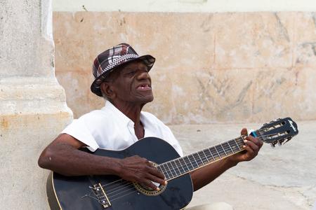 old people: HAVANA - APRIL 27, 2016: People in Old Havana (Havana Vieja)