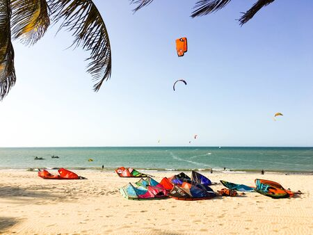 Kites and kitesurfers on the ocean in north Brazil
