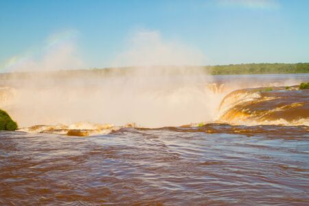 View of the Iguazu Iguacu) falls, the largest series of waterfalls on the planet, located between Brazil, Argentina, and Paraguay. At some times during the year one can see as many as 275 separate waterfalls cascading along the edges of 2,700 meters (1.6  Stock Photo