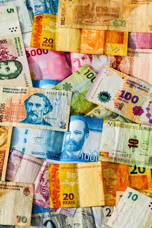 denominations: Colorful background of mixed banknotes of south and central american currencies Stock Photo