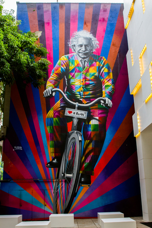 SAO PAULO - APRIL 10: Streetart work by Brazilian artist Kobra, representing Einstein on a bike and the message you and me equals love on the streets of Sao Paulo, Brazil on April 10th, 2017