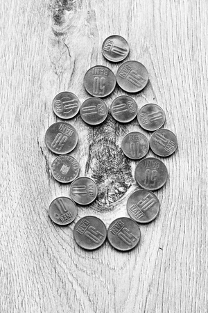 rumanian: Mix of romanian coins on rustic wooden background Stock Photo