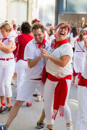 basque country: BAYONNE, FRANCE - JULY31: Unknown people dresses in traditional red and white clothes enjoying the Fetes de Bayonne festivals in the Northern Basque Country in the town of Bayonne, France on July 31st, 2017