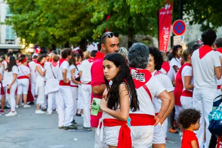BAYONNE, FRANCE - JULY31: Unknown people dresses in traditional red and white clothes enjoying the Fetes de Bayonne festivals in the Northern Basque Country in the town of Bayonne, France on July 31st, 2017
