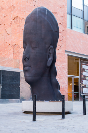 BARCELONA - MAY 01:  Carmela iron sculpture by the artist, sculptor and engraver Jaume Plensa in virtual corner outside The Palau de la Musica Catalana concert hall in Barcelona, Spain on May 1st, 2017 Editorial
