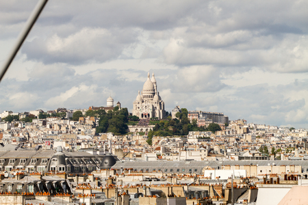 sacre coeur: PARIS - SEPTEMBER 02:  View of Paris rooftops in Montmartre, and the Basilica of the Sacre Coeur seen from the Centre Pompidou in Paris, France on September 2nd, 2017