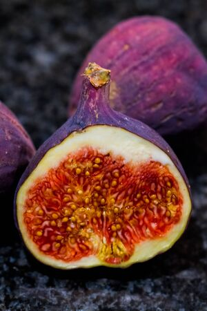 Macro of ripe common fig (Ficus carica) fruit over dark background