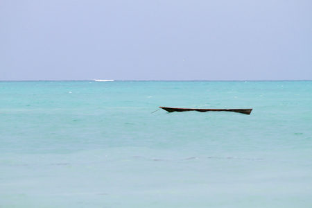 Landscape with sparkling blue water off the white beaches of the Indian Ocean spice island of Zanzibar (Unguja), Tanzania