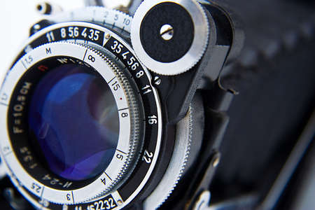 objectivity: Objective of a black ancient photocamera close up Stock Photo
