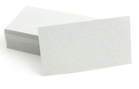 name calling: The pile business cards lays propped up another business card on a white background