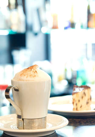 The cup of espresso costs on a table on a background of a pie Stock Photo - 3224955