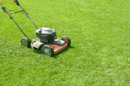 The lawn-mower costs on green a lawn Stock Photo - 3224987
