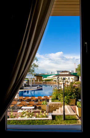 staying in shape: Beautiful view from the window on swimming pool