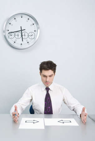 The young businessman has difficulties with events in the decision photo