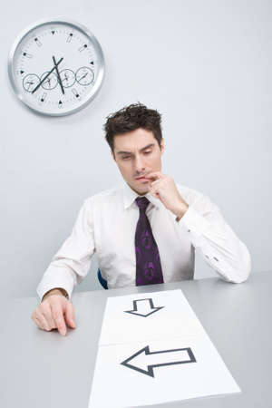The young businessman has difficulties with events in the decision Stock Photo - 4673437