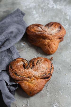 Sweet Soft Buns. Puff pastry bun with custard, raisins and chocolate Bakery