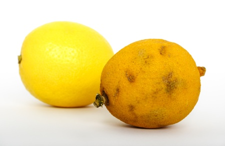 stale: Stale and fresh lemons isolated on white background