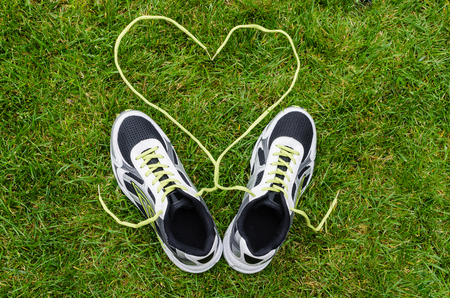 White sneakers for running on grass with heart Imagens