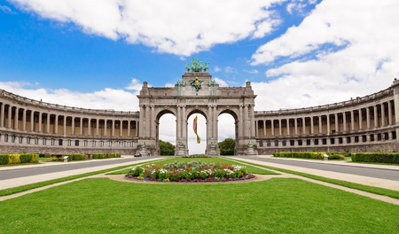 brussels: The Triumphal Arch in Cinquantenaire Parc in Brussels, Belgium with flowers in summer Stock Photo
