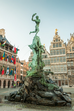 Antwerps city hall with the Brabo fountain and with Belgian houses on the Great Market Square